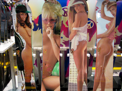 ... cropped images of nude women as artwork on the deck of the snowboards.
